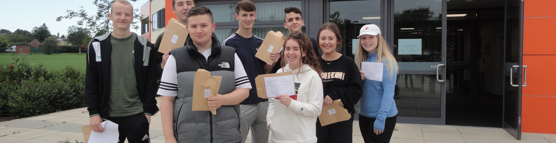 A-level students at Ashington Academy collect their results